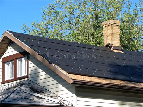 Tar paper on a roof stock photo