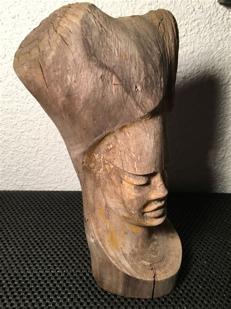 Face carved into section of wood is it African?   Antiques